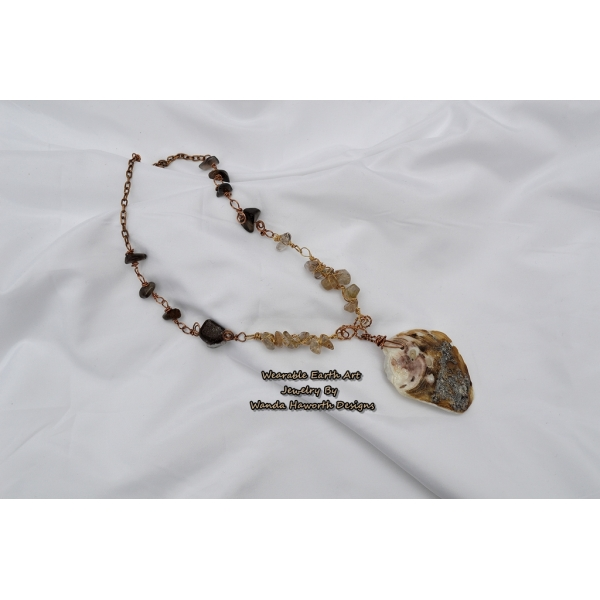 Sea shell pendant with rutilated and smokey quartz accent stones