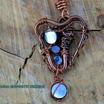 Heart shaped copper pendant