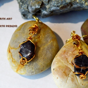 Banded BC agate drops hand wired with gold anodized copper wire there is a light oak bead mounted on the body it features gold ear wires