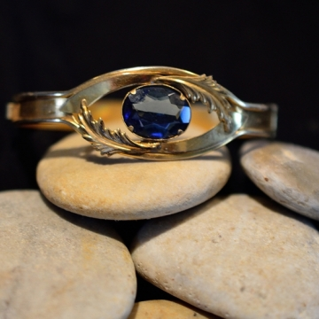 Vintage jewelers brass bracelet , Center mounted faceted blue Swarovski crystal , Hinge closure , Excellent quality from the 1900's