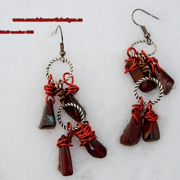 South African Red Tigers Eye Earrings Hand Wired With Antique Copper Wire Joined Together With Twisted Pewter Hoops The Hooks Are Stainless